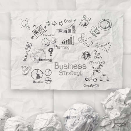 project: hand drawing creative business strategy on crumpled paper background as concept