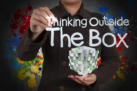 thinking outside the box and splash colors as concept photo