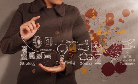 la main d'affaires travaillant avec l'art de la stratégie de l'entreprise en tant que concept