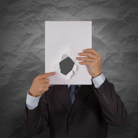 businessman hand show black cover book with crumpled recycle paper background  as concept photo