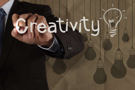 businessman hand draws creativity light bulb with recycle envelope background as creative concept Stock Photo - 22393335