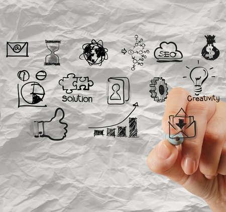 growth opportunity: hand drawing creative business strategy on crumpled paper background as concept