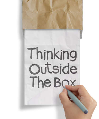 hand draws thinking outside te box on crumpled paper as concept photo