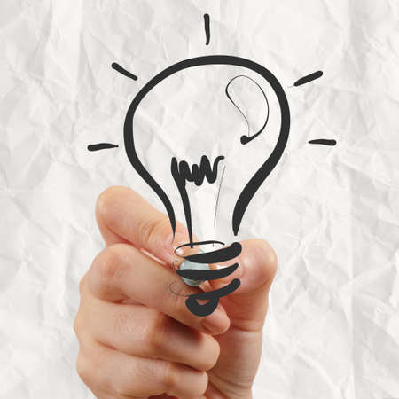 hand drawing light bulb with crumpled paper as creative concept photo