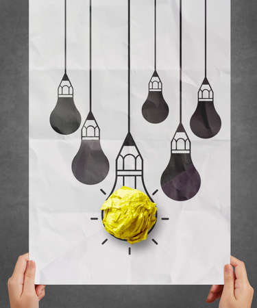 crumpled paper: light bulb crumpled paper in pencil light bulb as creative concept
