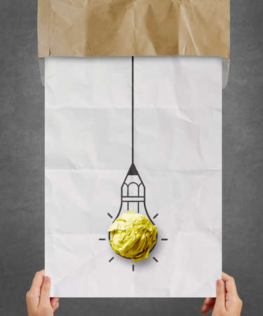 hand pulling light bulb crumpled paper out of recycle envelope as creative concept Stock Photo - 22393467