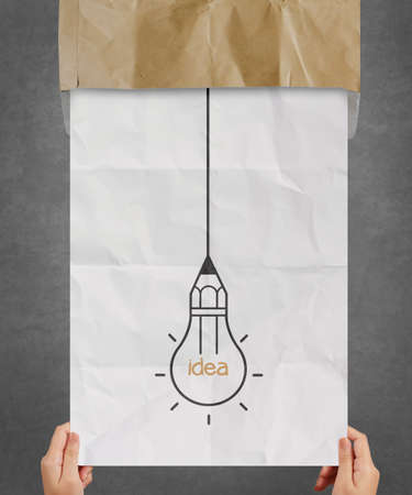 hand pulling light bulb crumpled paper out of recycle envelope as creative concept Stock Photo - 22393469