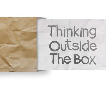thinking outside te box on crumpled paper as concept photo