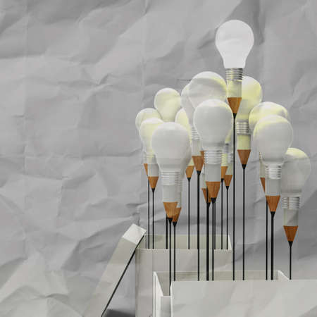 drawing idea pencil and light bulb concept outside the box as creative on crumpled paper  photo