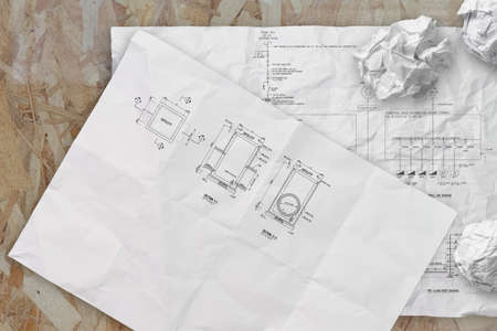 electronic single line and fire alarm riser schematic diagram on crunpled paper photo