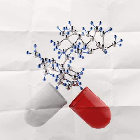 medical capsule and molecule structure on crumpled paper as concept photo