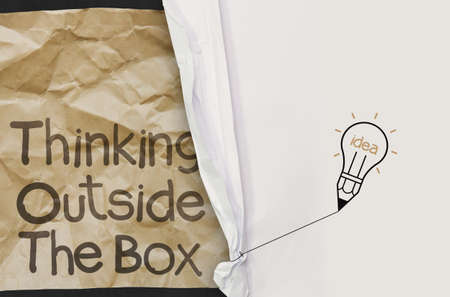 wrinkled paper show think outside the box with crumpled paper background as concept photo