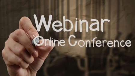 hand writing Webinar with crumpled paper background as concept Stock Photo - 22396973