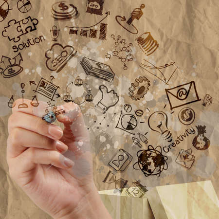 hand draws think outside the box as creative and leadership concept with crumpled recycle paper background photo