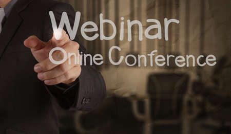 hand writing Webinar with crumpled paper background as concept Stock Photo - 22393783
