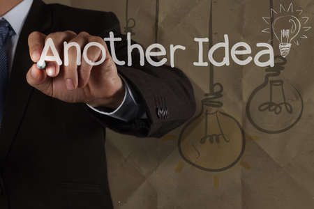 best idea: businessman hand draws another idea light bulb with recycle envelope background as creative concept Stock Photo
