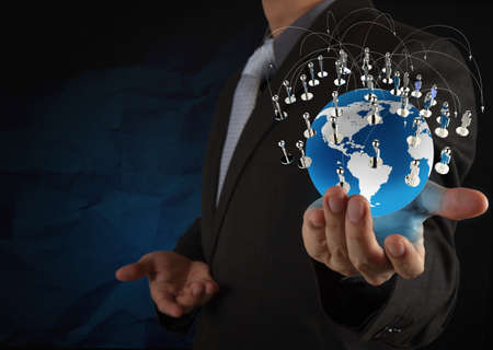 businessman show social network structure with crumpled recycle paper background as concept photo