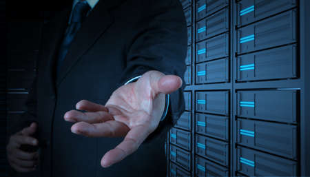 businessman open hand and server room background photo