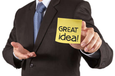 businessman hand show great idea words on sticky note with white background as concept photo