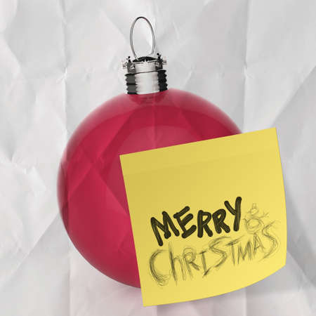 Empty Christmas ball ornament on crumpled paperand sticky note background photo