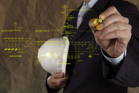 electrical fire: engineer draws an electronic single line and fire alarm riser schematic diagram with crumpled paper background