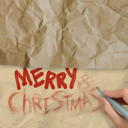 hand draws Christmas Card on wrinkled paper as vintage style concept photo