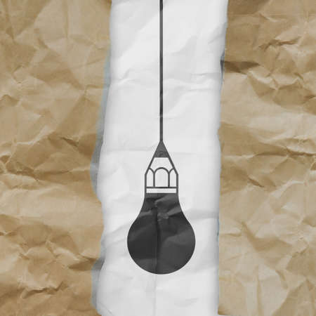 light bulb crumpled paper and recycle tear envelope as creative concept background photo