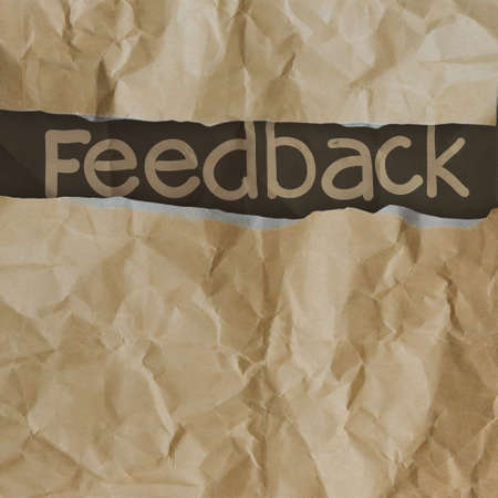 hand drawn feedback  words on crumpled paper with tear envelope as concept photo