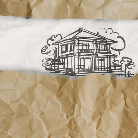 hand drawn house on wrinkled paper as concept photo