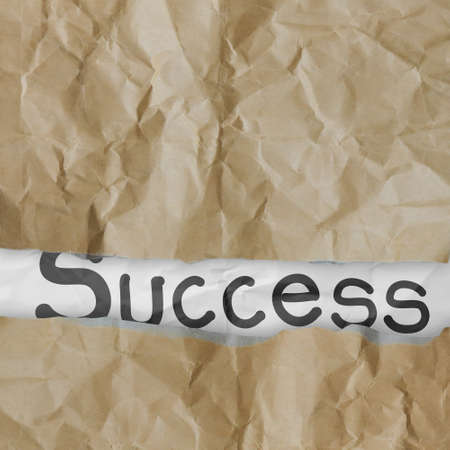 hand drawn success words on crumpled paper with tear envelope as concept Stock Photo - 22852461
