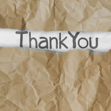 acknowledgment: hand drawn thank you words on crumpled paper with tear envelope as concept