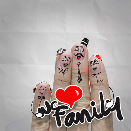happy finger couple in love with painted smiley on crumpled paper background photo