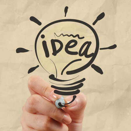 creative concept: hand drawing light bulb with crumpled paper as creative concept Stock Photo