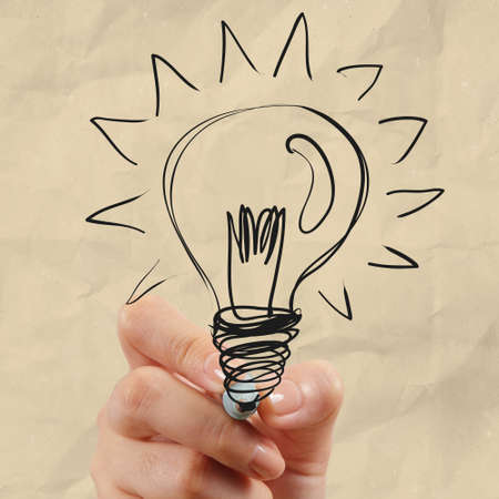hand drawing light bulb with crumpled paper as creative concept Stock Photo - 22852498