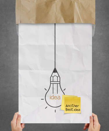hand showing sticky note with another idea light bulb on crumpled paper as creative concept Stock Photo - 22852555
