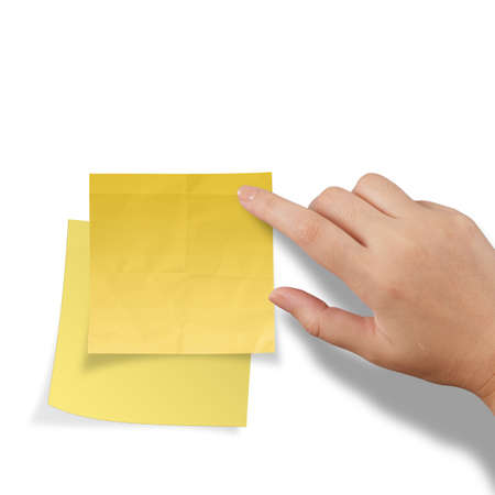 hand touch blank yellow sticky note on white background Stock Photo - 22852634