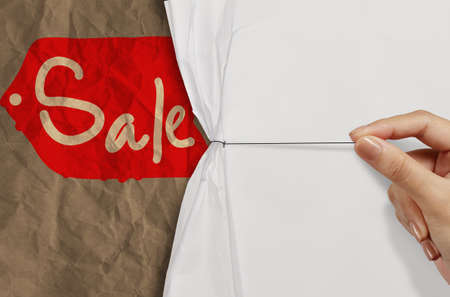 business hand pull rope open wrinkled paper show sale word  as concept photo