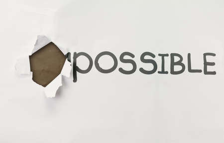 incentive: crumpled paper through word impossible transformed into possible as concept Stock Photo