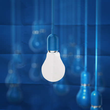 filaments: creative idea and leadership concept light bulb on crumpled paper background Stock Photo