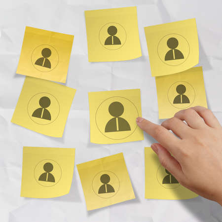 human gender: hand choosing people icon on sticky note with crumpled paper as human resources concept