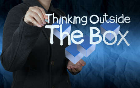 hand draws think outside the box with crumpled paper background as concept Stock Photo - 22852880