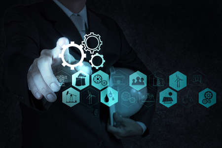 real world: businessman hand working with new computer interface show building development concept Stock Photo
