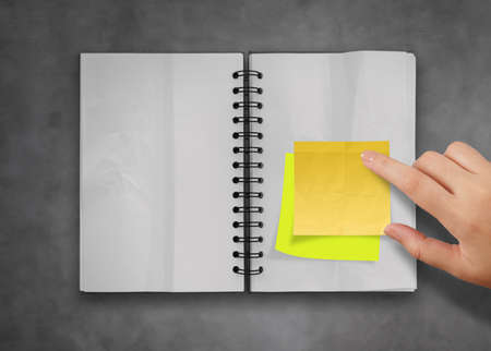 sticky notes with open blank note book on deak top texture Stock Photo - 23401400