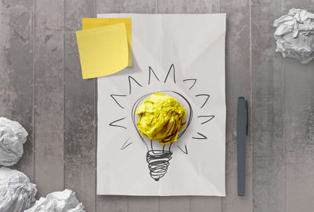 crumpled paper: sticky note with another idea light bulb on crumpled paper as creative concept Stock Photo