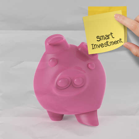 smart investment with sticky note on piggy bank 3d standing over coin as concept photo