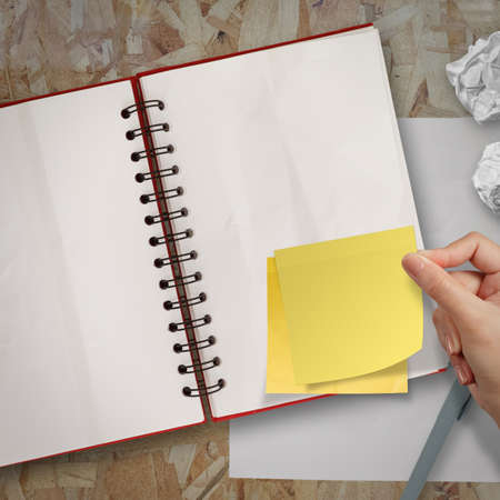 sticky notes with blank open note book on recycle wood desk top photo