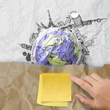 human geography: sticky note on recycle envelope with crumpled paper and traveling around the world as vintage style concept
