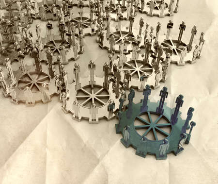 Model of 3d figures on connected cogs as leadership concept on crumpled paper photo