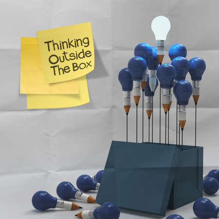 thinking outside the box on sticky note and pencil lightbilb as creative on crumpled paper photo