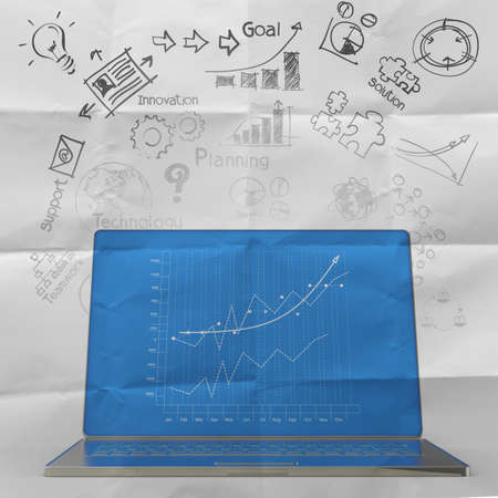 sticky note on crumpled paper with laptop computer and  business diagram as concept photo